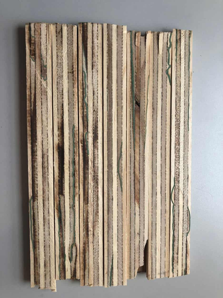 strips of wood glued together in a sheet