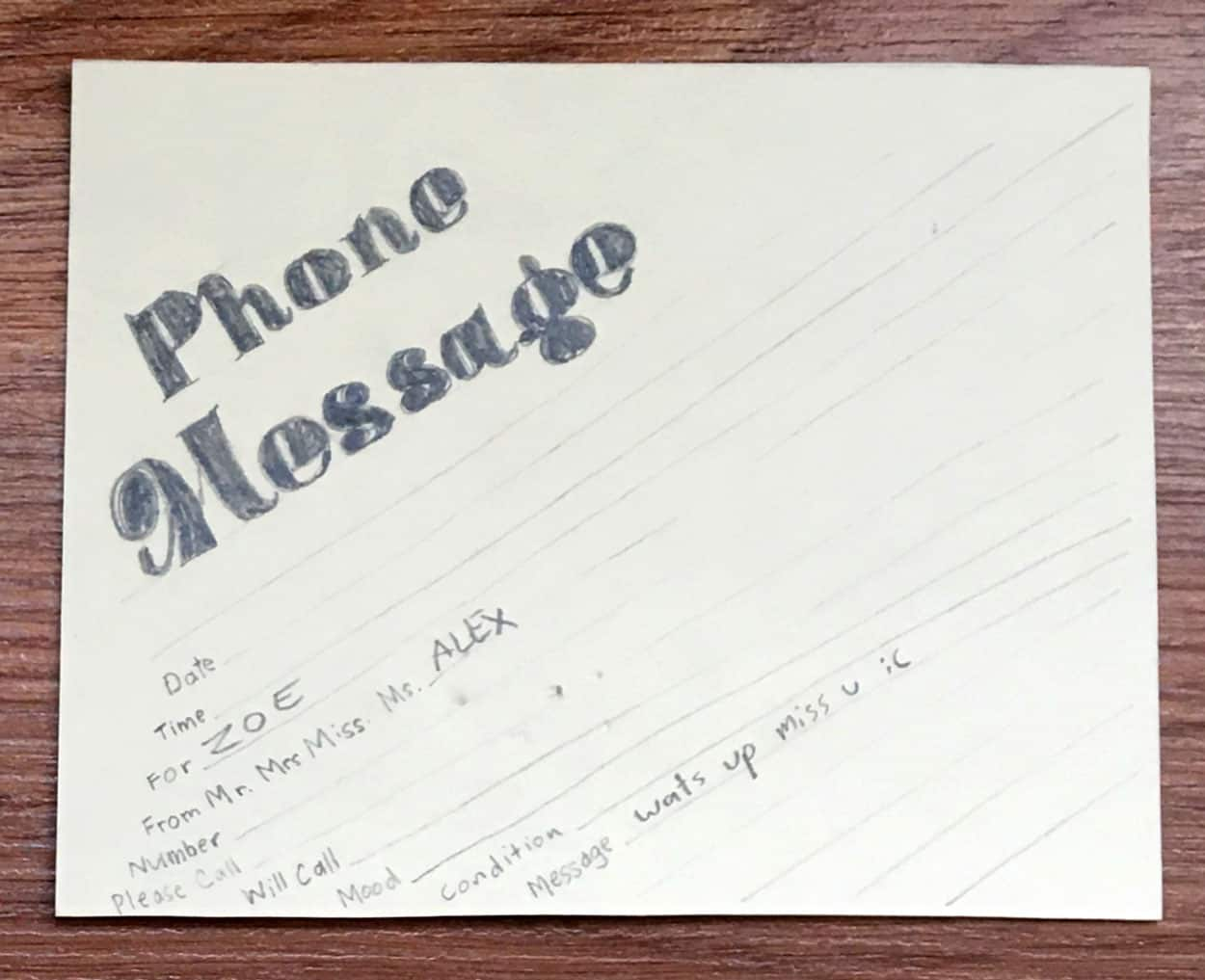 Graphite drawing reproduction of phone message slip. message for zoe from alex, 'wats up miss u :('