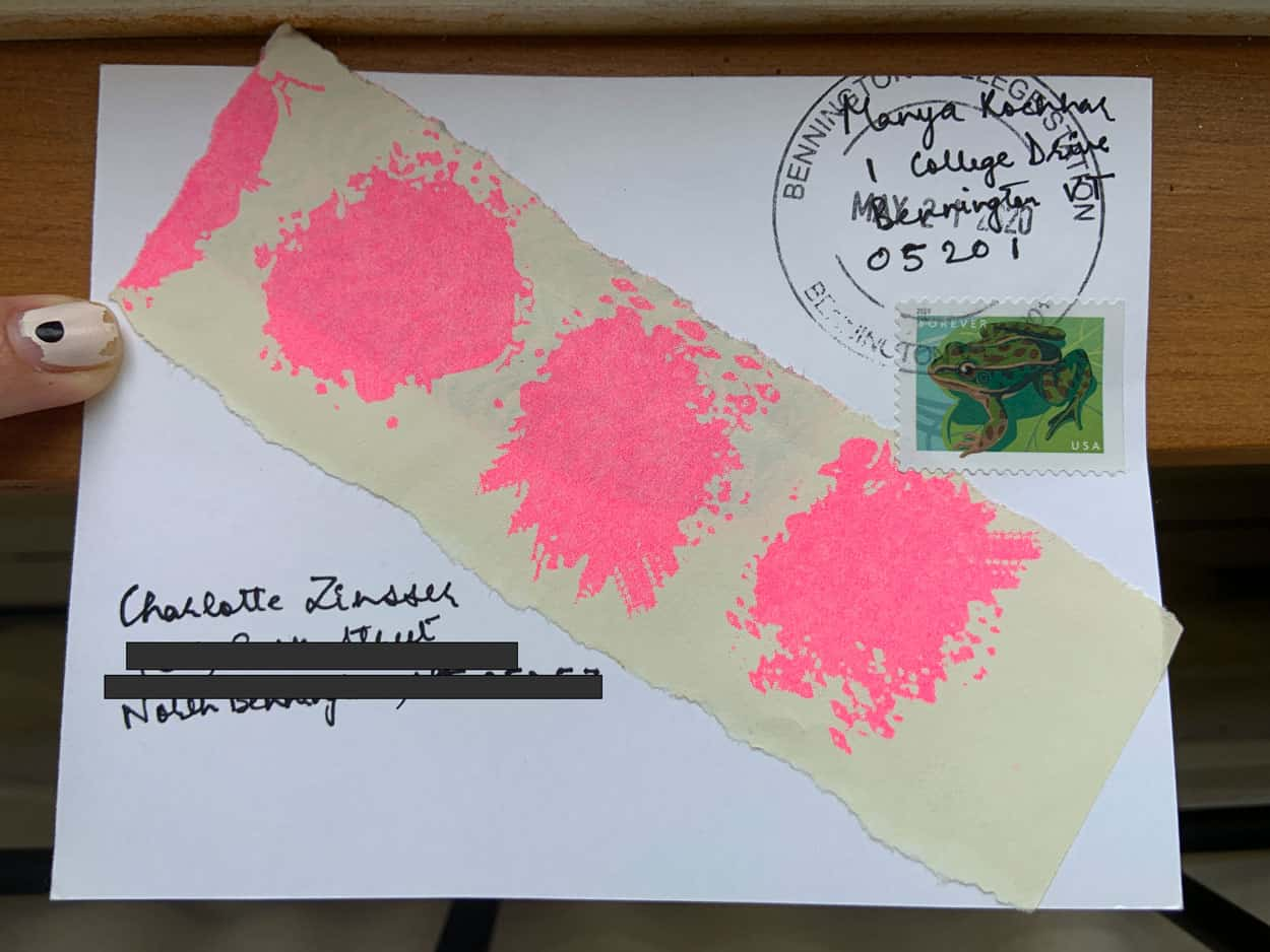 Back of postcard with addresses, Bennington college mail stamp, frog stamp, and piece of torn paper with four pink blobs.