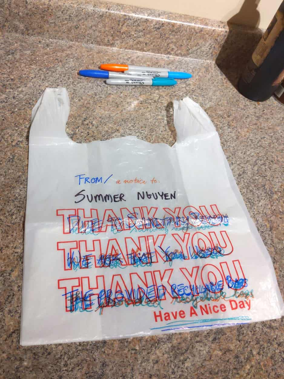 "plastic bag printed with ""thank you"" design, written over with permanent marker"