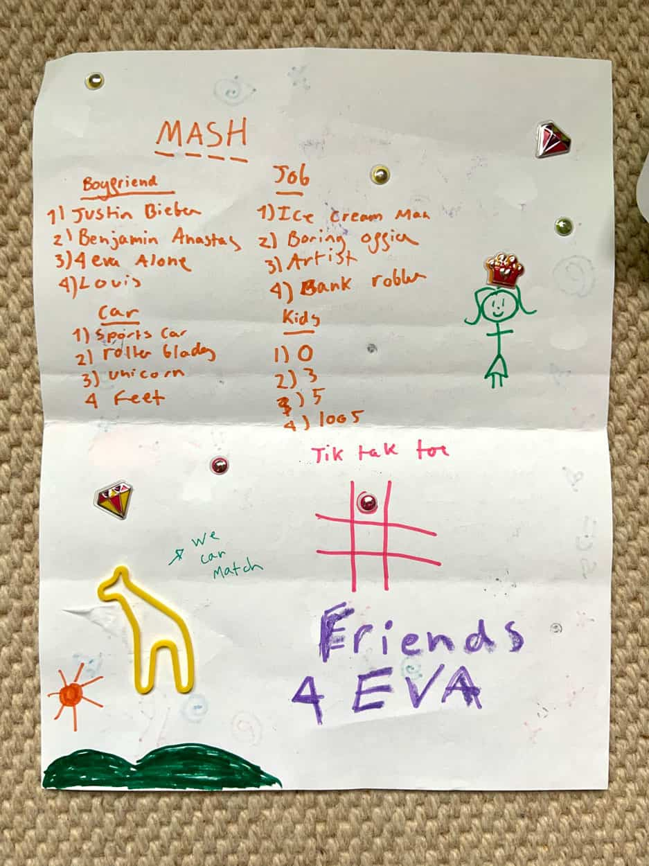 MASH game written on printer paper with marker, stickers, and silly band