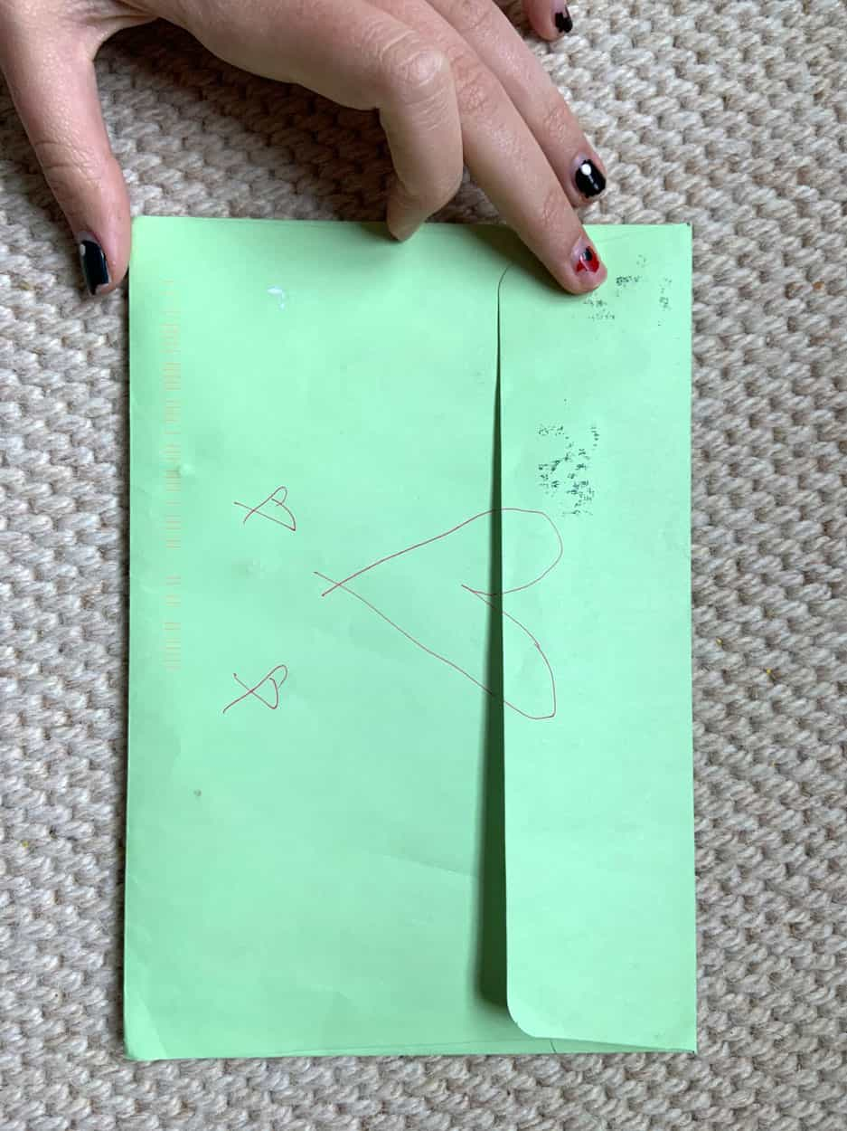 green envelope with drawings of hearts on flap