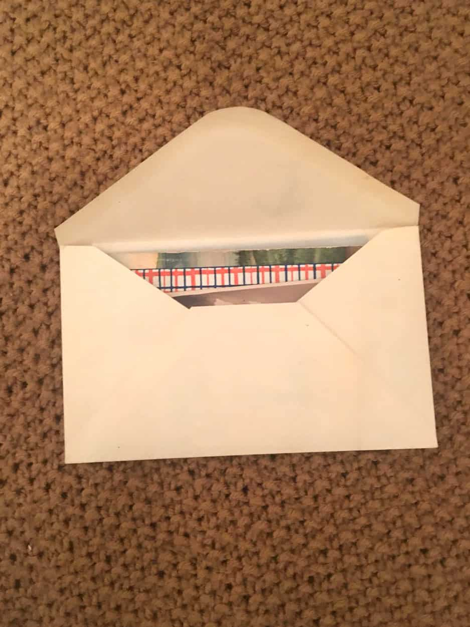 Open envelope with many pieces of differently patterned paper visible inside
