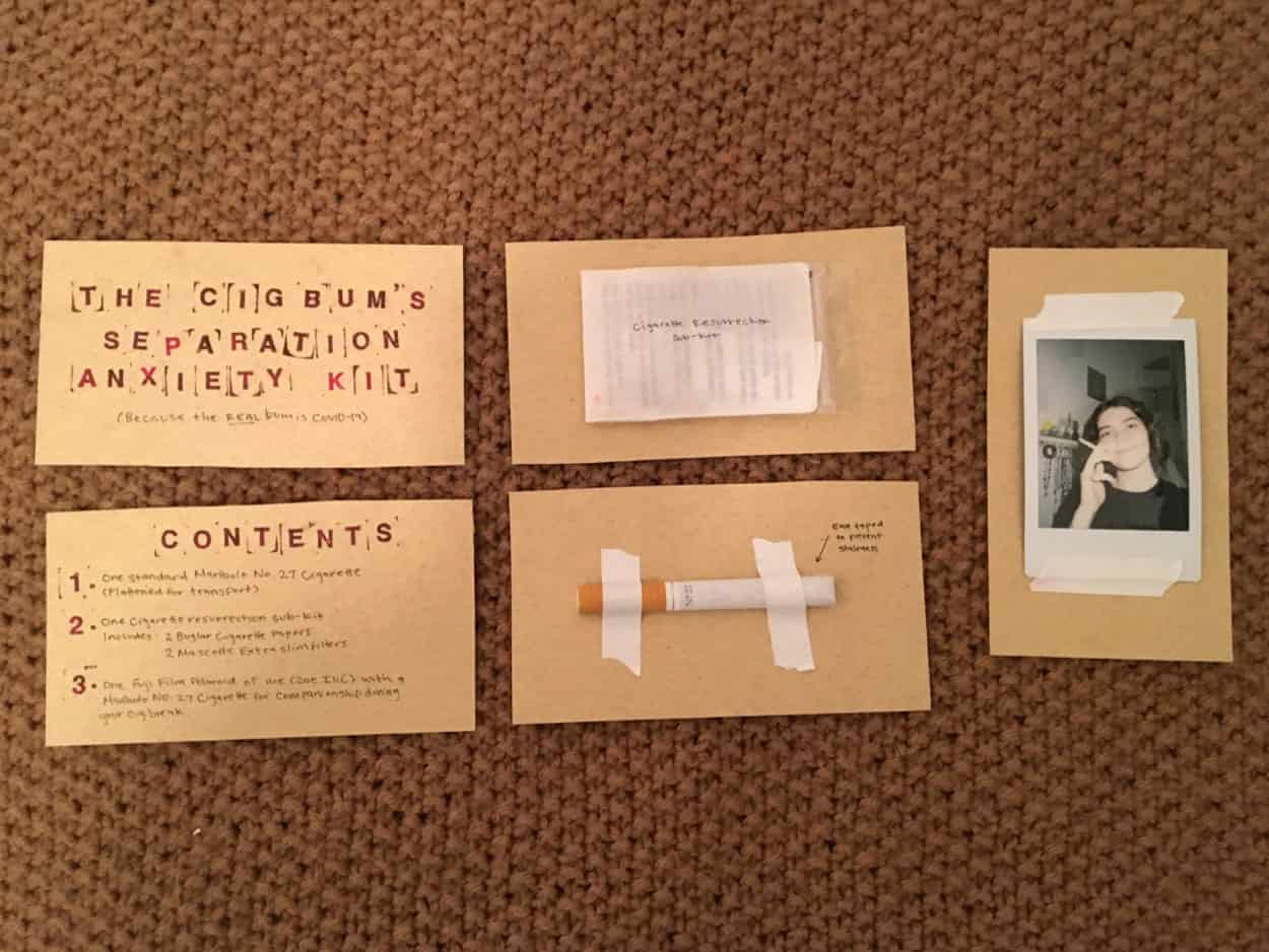 5 brown cards with writing and other materials taped to them such as cigarette, polaroid photo, small envelope.