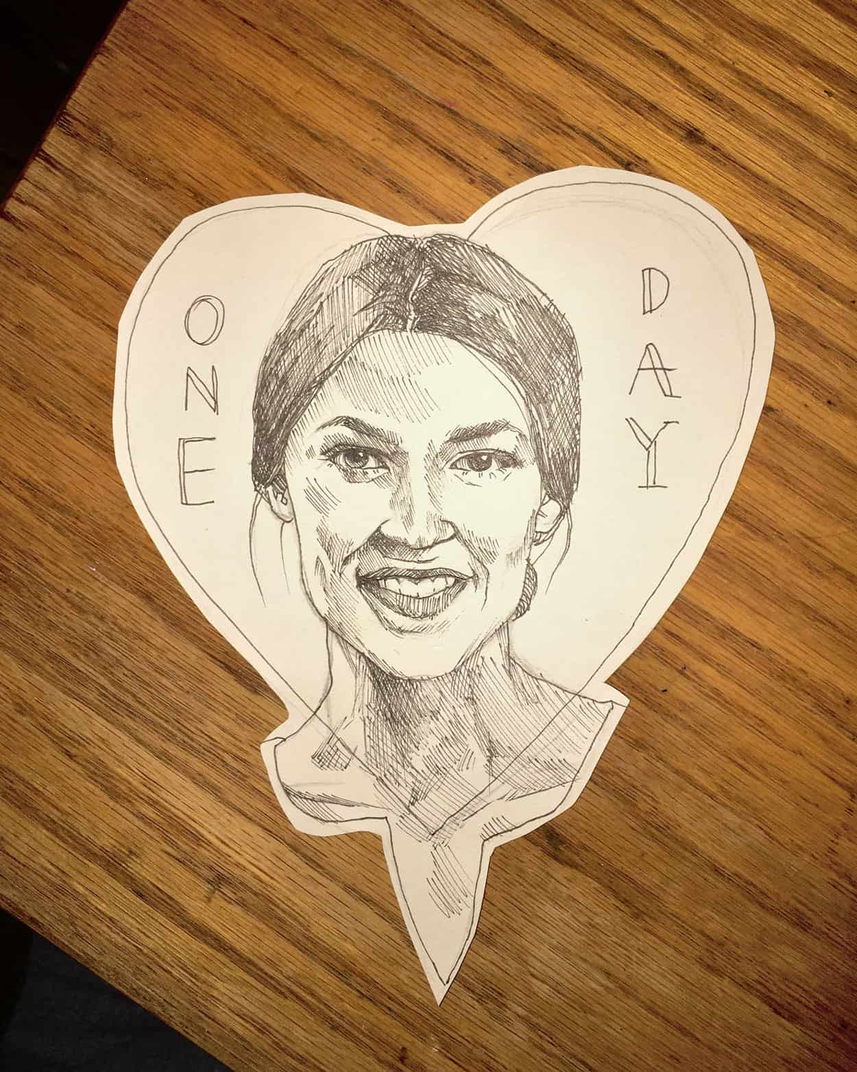 Hand drawn image of Alexandria Occasio Cortez inside a cutout of a heart. The text one day is on either side of her face.
