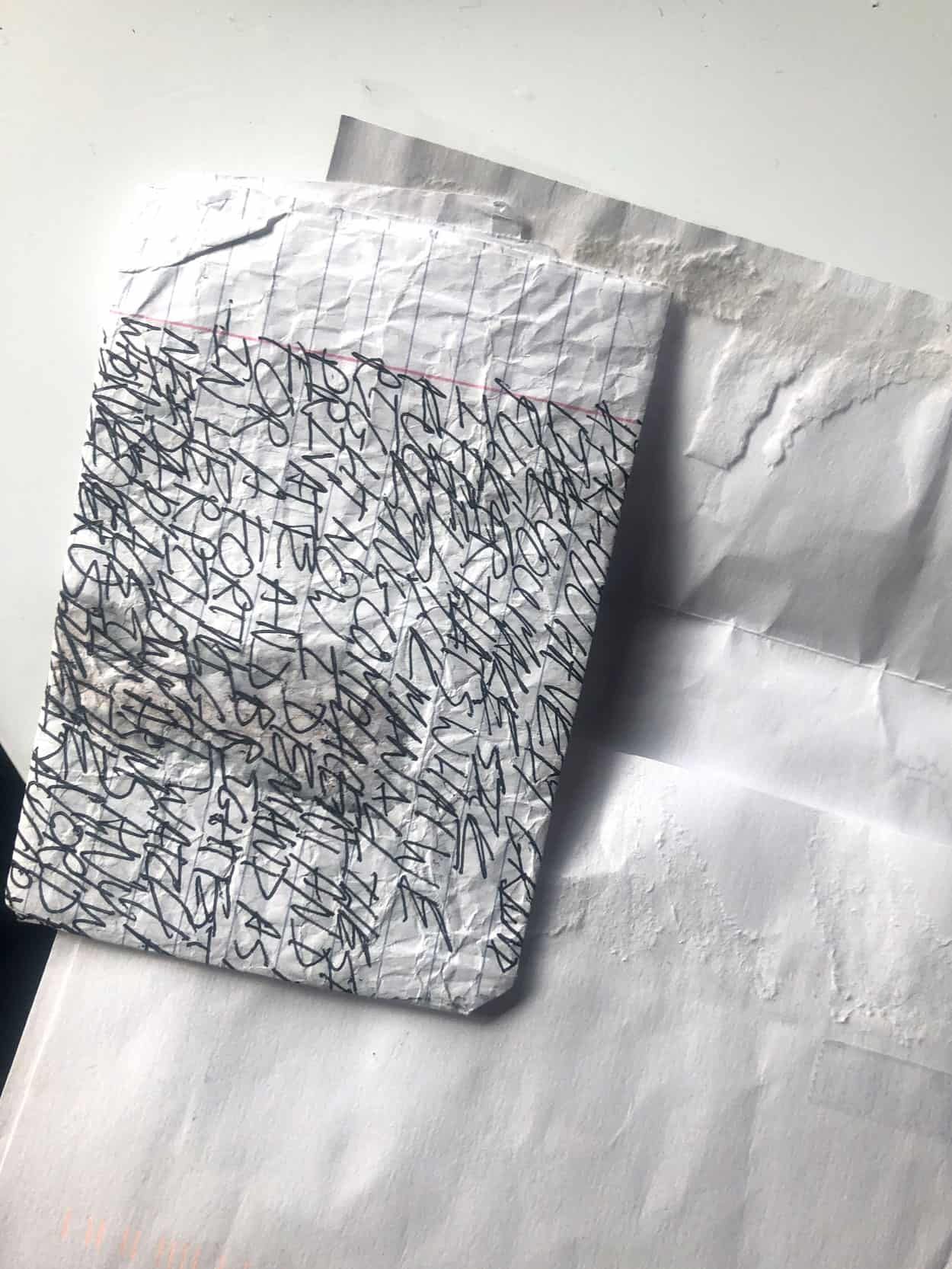 Photo of folded paper with writing