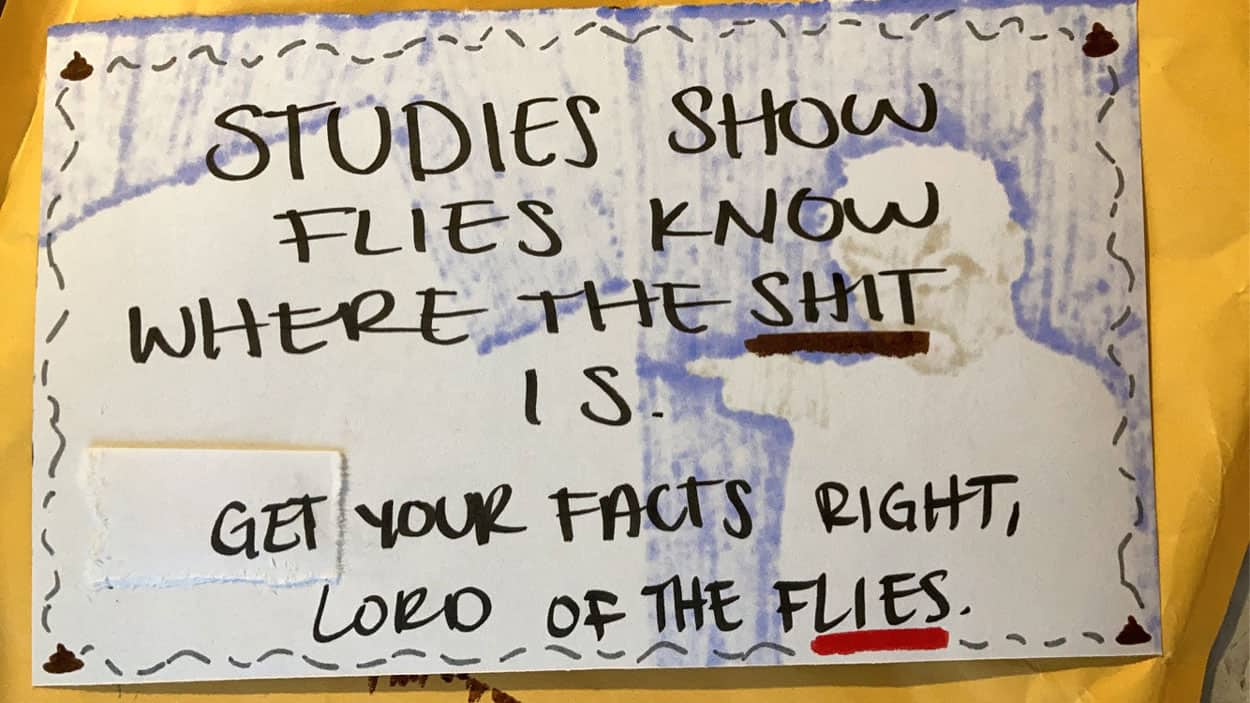 "Post card with the text ""Studies show know where the shit is. Get your facts right, lord of the flies"""