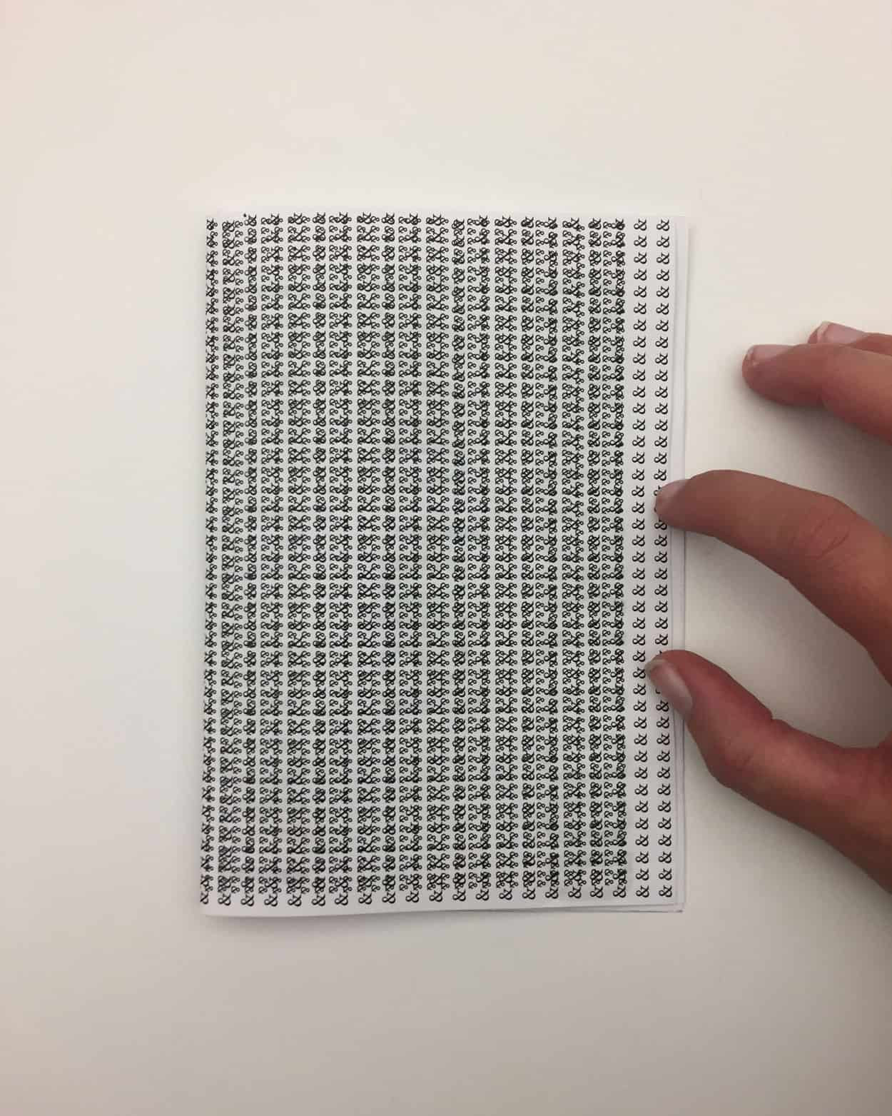 One side of a folded Piece pf paper. A repeating pattern covers the entire page.